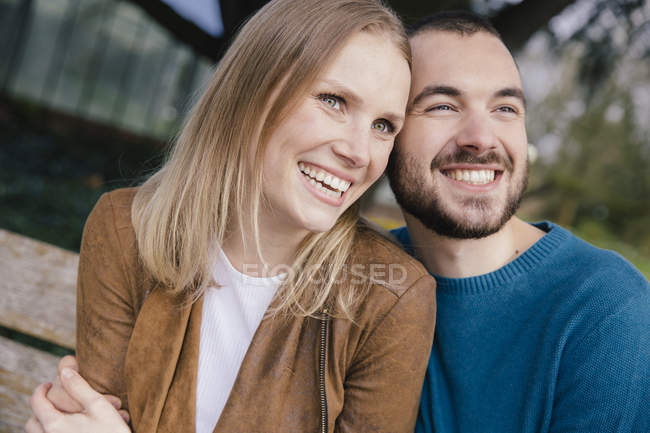 Portrait of happy young couple head to head — Stock Photo