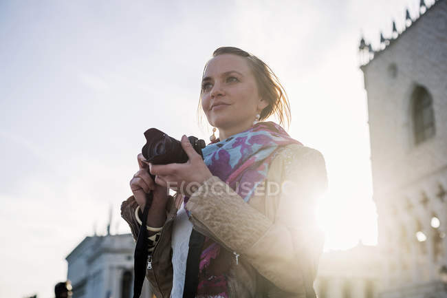 Female tourist taking pictures — Stock Photo