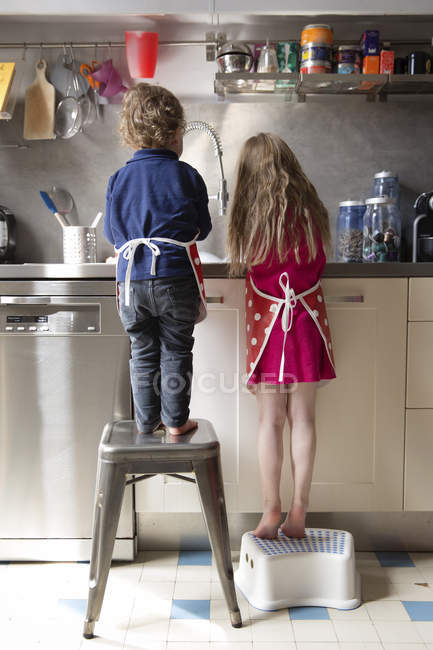 Miraculous Back View Of Little Boy And Girl Washing Dishes In The Creativecarmelina Interior Chair Design Creativecarmelinacom