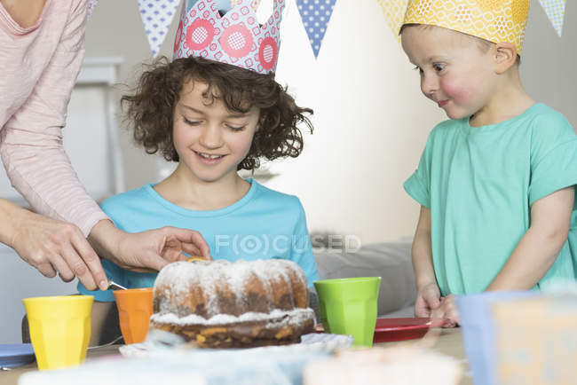 Girl having birthday party with cake at kitchen — Stock Photo