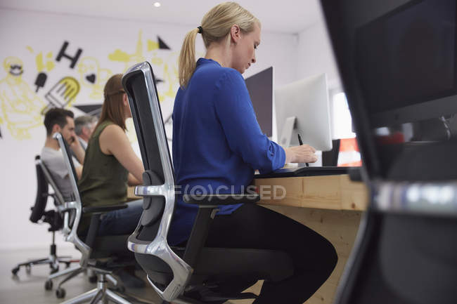 Employees working at computers in modern office — Stock Photo