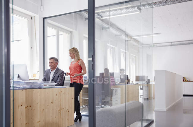 Caucasian people working in modern office — Stock Photo