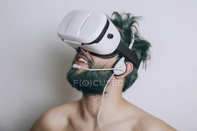 Shirtless man wearing Virtual Reality Glasses and headset — Stock Photo