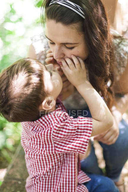 Mother and little son playing together in nature — Stock Photo