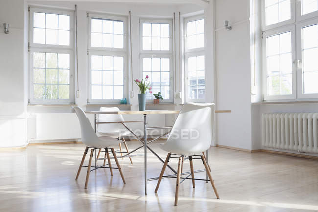 Home interior with table and chairs — Stock Photo