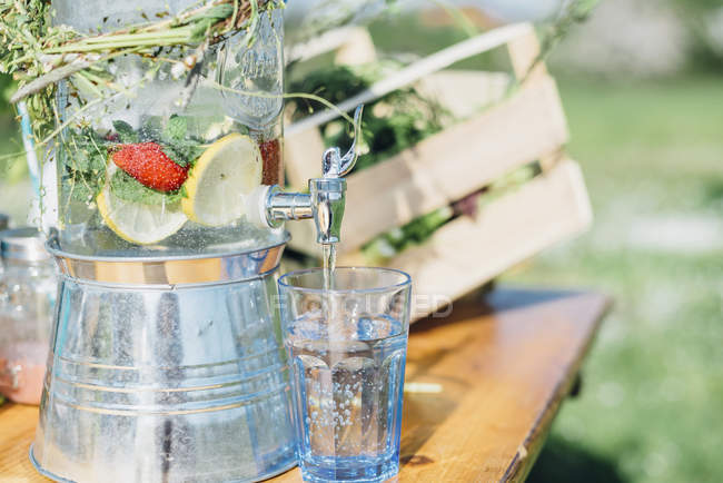 Water on outdoor table — Stock Photo