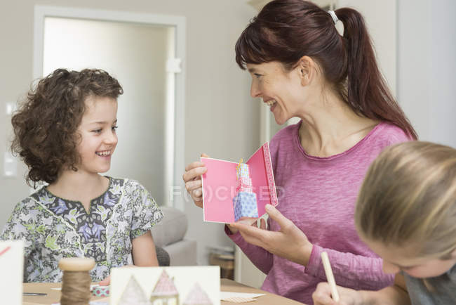 Mother and daughters making greeting cards — Stock Photo