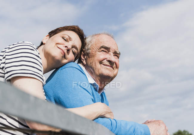 Happy woman head to head with his old father — Stock Photo