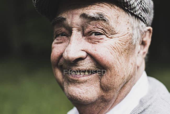 Portrait of smiling senior man — Stock Photo