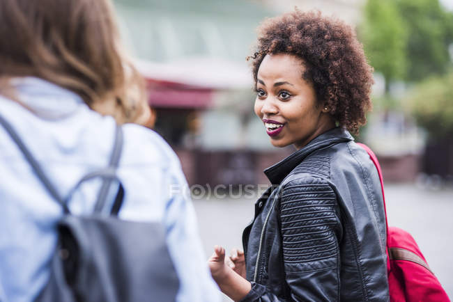 Portrait of astonished young woman looking at her friend — Stock Photo