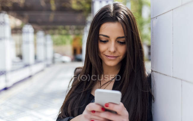Young attractive woman using smartphone — Stock Photo