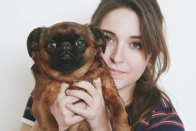 Portrait of young woman and her dog — Stock Photo