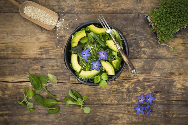 Detox bowl of lettuce and star-flowers — Stock Photo