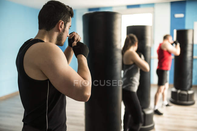 Sporty focused people boxing in gym — Stock Photo