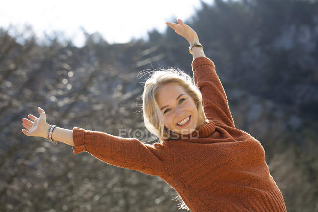 Portrait of happy teenage girl with raised arms — Stock Photo