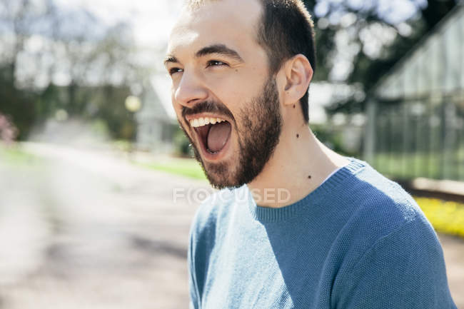 Portrait of young man crying for joy — Stock Photo