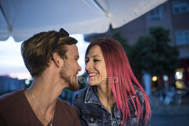 Young couple outdoors  on the street — Stock Photo