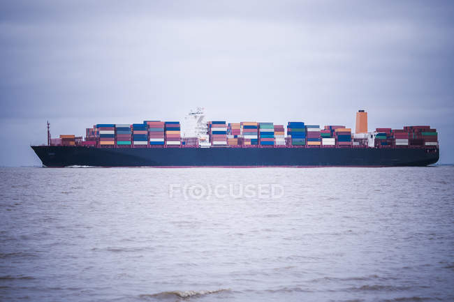 Germany, near Cuxhaven, North Sea, loaded container ship — Stock Photo