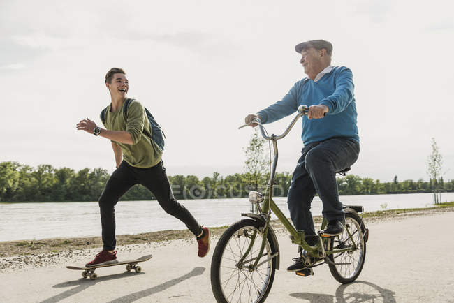 Grandfather and grandson having fun together at riverside — Stock Photo
