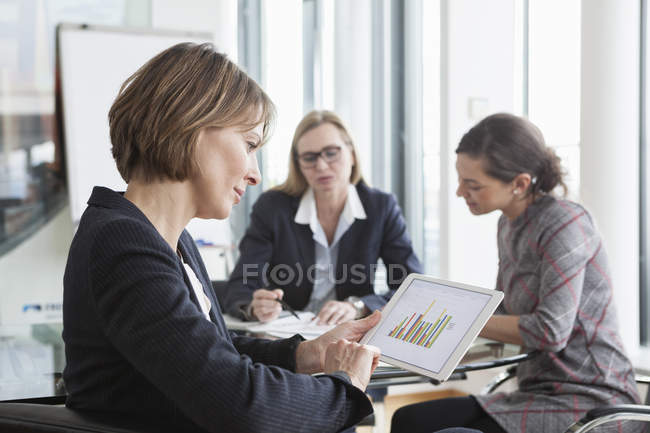 Businesswoman using digital tablet in a meeting — Stock Photo