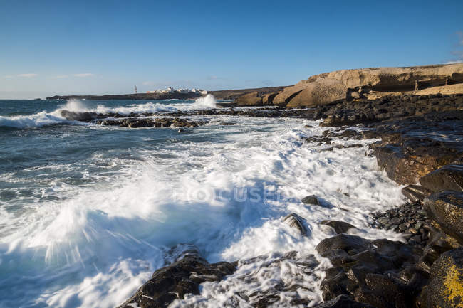 Spain, Tenerife, rocky coast and surging billows — Stock Photo
