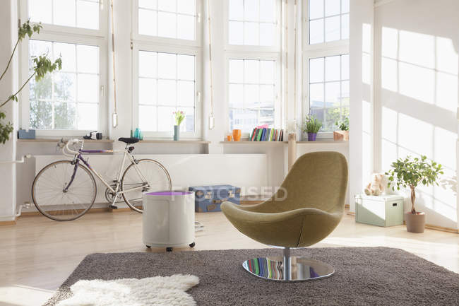 Home interior with bicycle and chair — Stock Photo