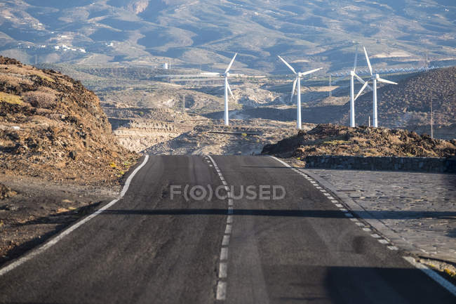 Spain, Tenerife, empty road and windpark view, mountains on background — Stock Photo