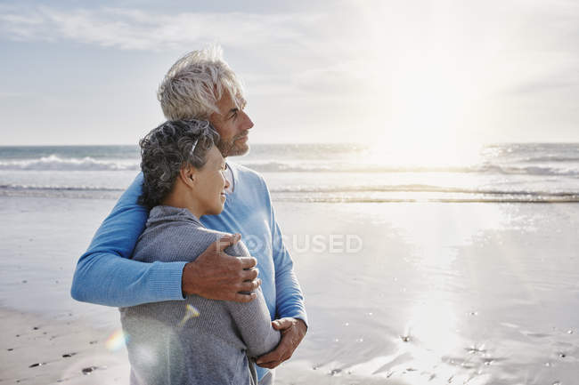 Happy couple embracing on the beach — Stock Photo