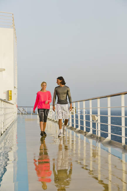 Couple walking in the morning light on a shipdeck, cruise ship, Mediterranean Sea — Stock Photo