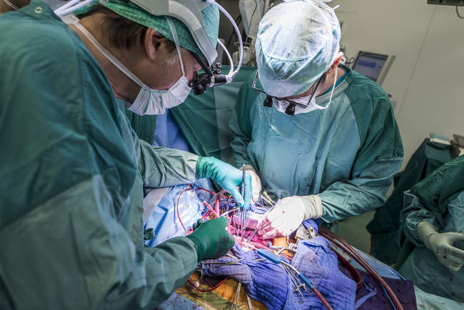 Heart surgeons during a heart operation — Stock Photo
