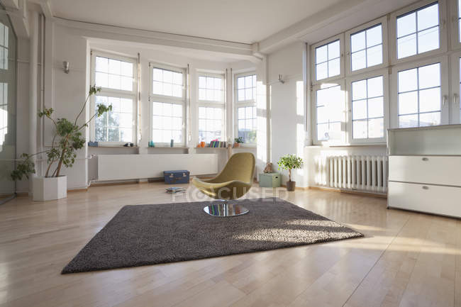 Home interior with carpet and chair — Stock Photo