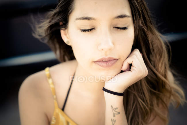 Portrait of young woman with closed eyes — Stock Photo