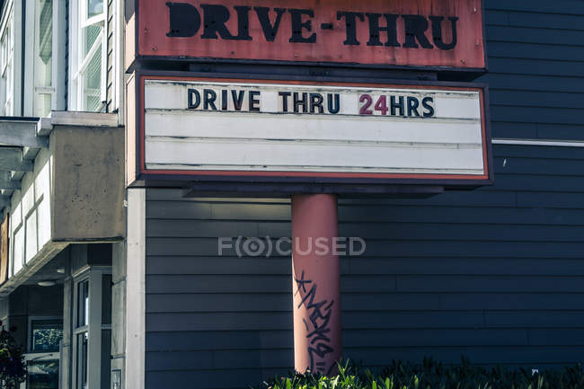 Canada, drive-thru sign against wall — Stock Photo