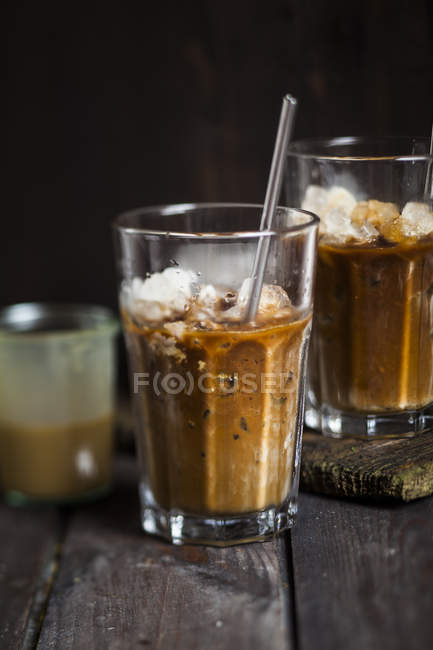 Vietnamese iced coffee with sweetened condensed milk in glasses — Stock Photo