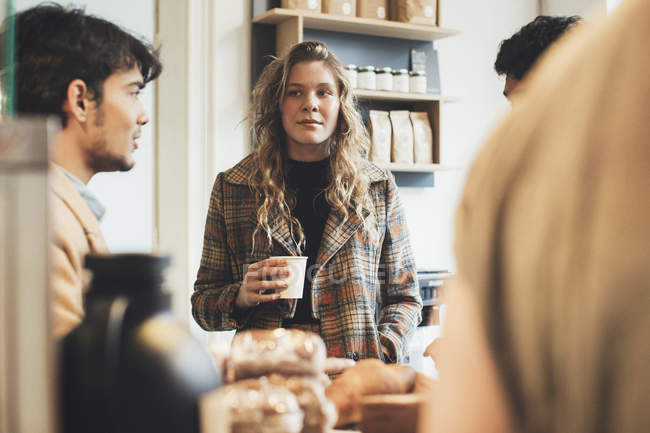 Friends meeting in a cafe — Stock Photo
