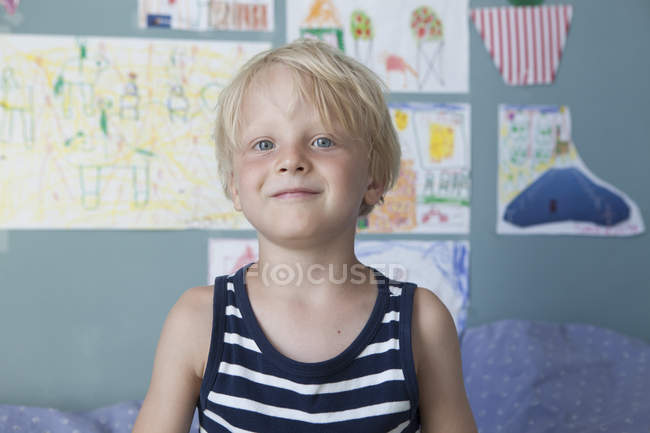 Portrait of confident little blond boy at children's room — Stock Photo