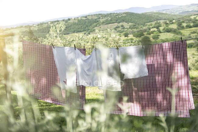 Italy, Tuscany, laundry drying on washing line — Stock Photo