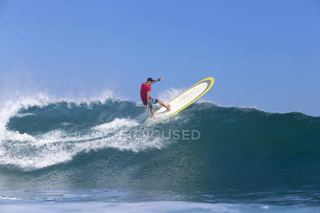 Indonesia, Bali, Surfer on wave — Stock Photo