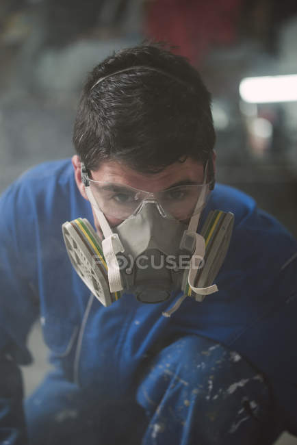 Portrait of a construction worker with protective mask — Stock Photo