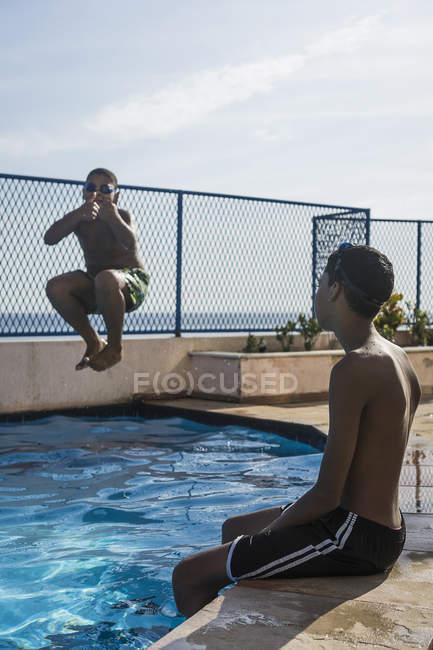 Two boys having fun in swimming pool — Stock Photo