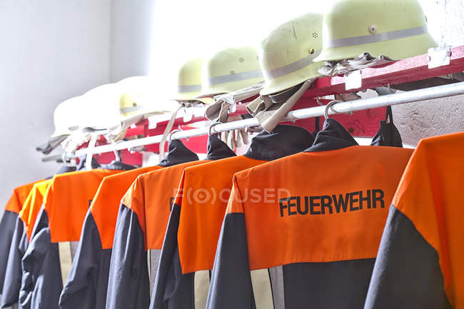 Fire brigade protective clothing in equipment building — Stock Photo