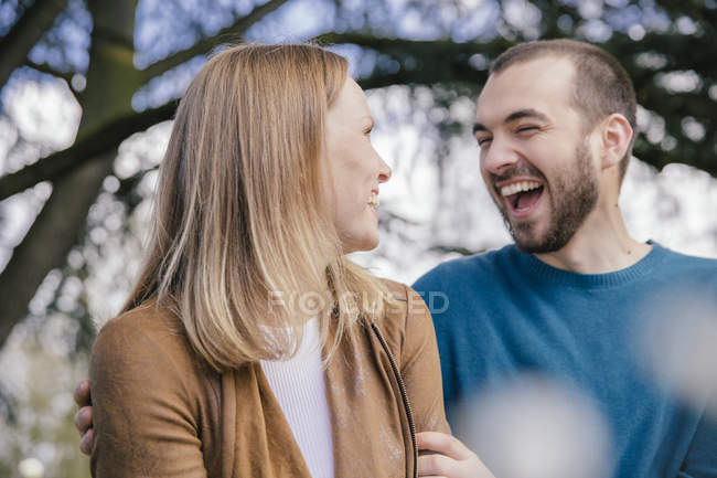 Laughing young couple in the  botanical garden — Stock Photo