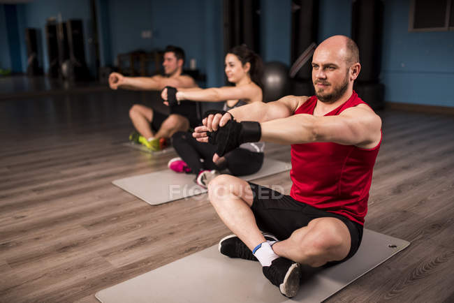 People having yoga and stretching class at gym — Stock Photo