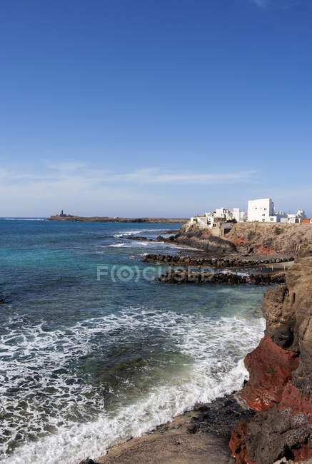 Distant view of El Puertito de la Cruz, Lighthouse at Punta de Jandia, Fuerteventura, Canary Islands, Spain — Stock Photo