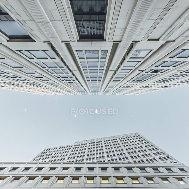 Germany, Berlin, flying heart-shaped balloons between two skyscrapers seen from below — Stock Photo
