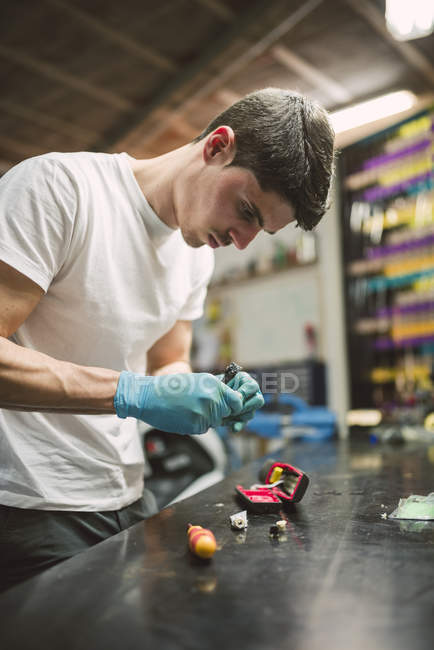 Young Electronic technician repairing in workshop — Stock Photo