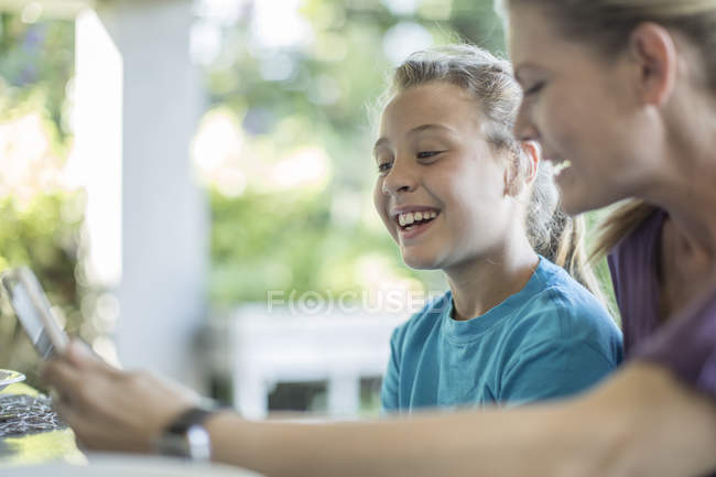 Mother and daughter watching something at home — Stock Photo