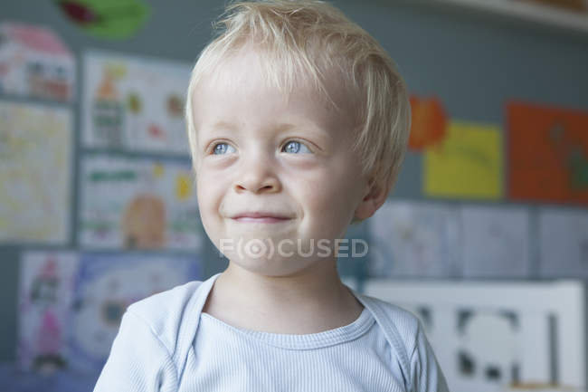 Portrait of smiling little blond boy at home — Stock Photo