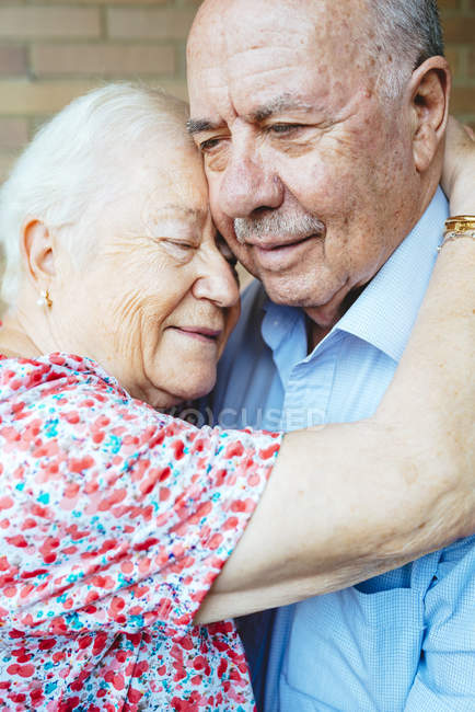 Happy senior woman embracing her husband — Stock Photo