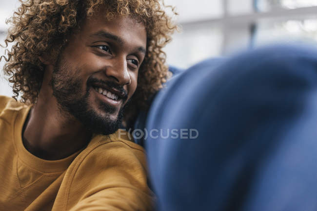 Smiling young man with Afro curls, portrait — Stock Photo